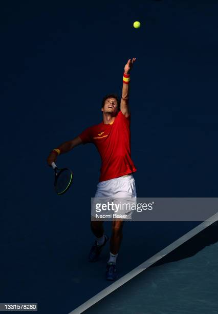 Pablo Carreno Busta of Team Spain serves during his Men's Singles Bronze Medal match against Novak Djokovic of Team Serbia on day eight of the Tokyo...