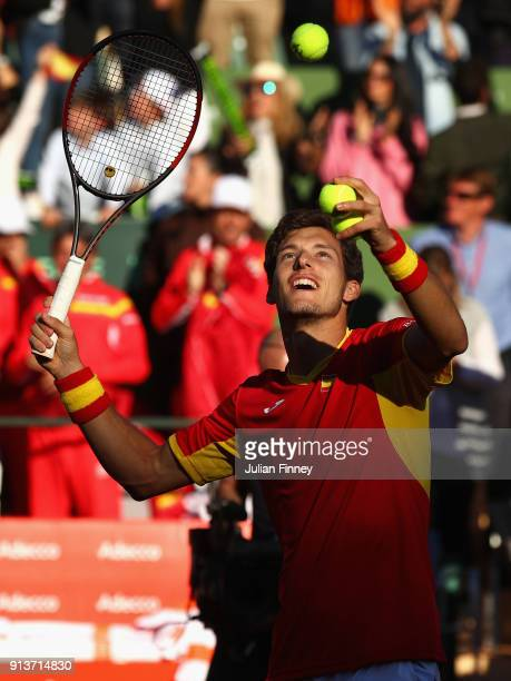 Pablo Carreno Busta with Feliciano Lopez of Spain celebrates defeating Dom Inglot and Jamie Murray of Great Britain after their straight sets win in...