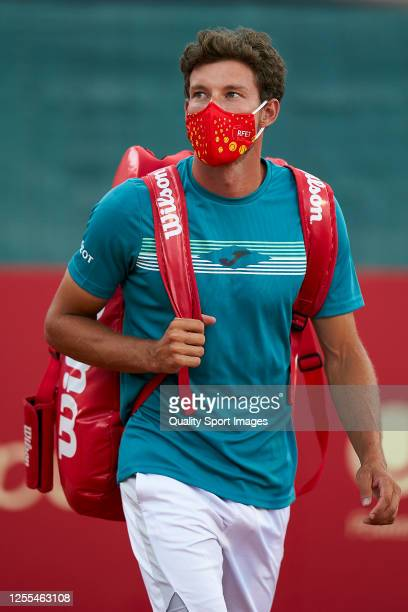 Pablo Carreno of Spain comes onto the court wearing a mask prior to the match between Pablo Carreno and Carlos Taberner of La Liga MAPFRE at Centre...
