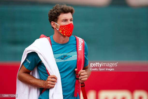Pablo Carreno of Spain comes onto the court wearing a mask prior to the match between Albert Ramos and Pablo Carreno of La Liga MAPFRE at Centre...