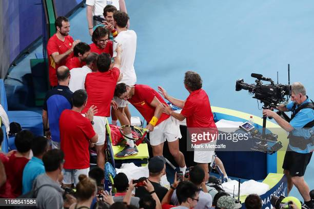 Pablo Carreño Busta and Rafael Nadal of Spain celebrate with team mates after winning their quarter final doubles match against Sander Gille and...