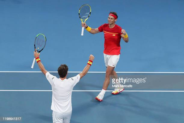 Pablo Carreño Busta and Rafael Nadal of Spain celebrates winning match point during during their quarter final doubles match against Sander Gille and...