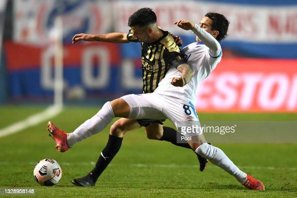 Pablo Ceppelini of Peñarol competes for the ball with Gabriel Neves of Nacional during a round of sixteen match between Nacional and Peñarol as part...