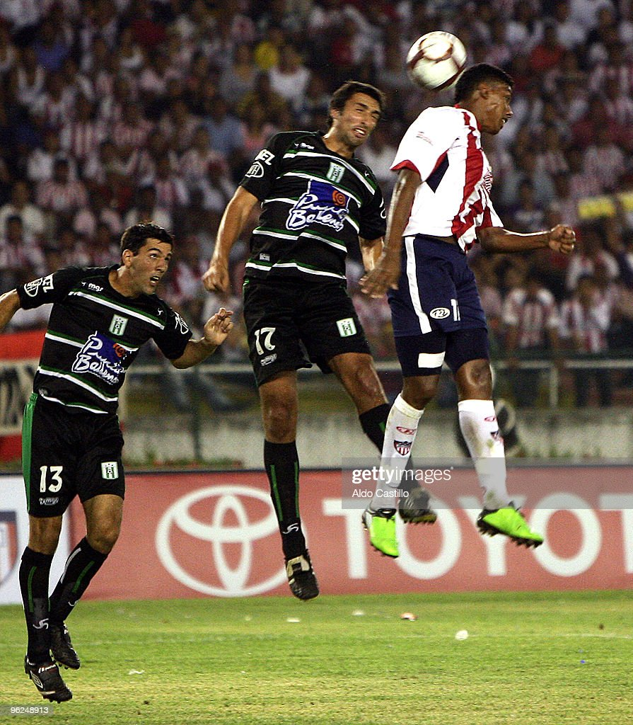 Pablo Cesar Arango (R) of Colombia's Atletico Junior vies for the ball with Ignacio Pallas and Danny Tejera of Uruguay's Racing during a match as part of the 2010 Santander Libertadores Cup at the Metropolitano Roberto Melendez Stadium on January 28, 2010 in Barranquilla, Colombia.
