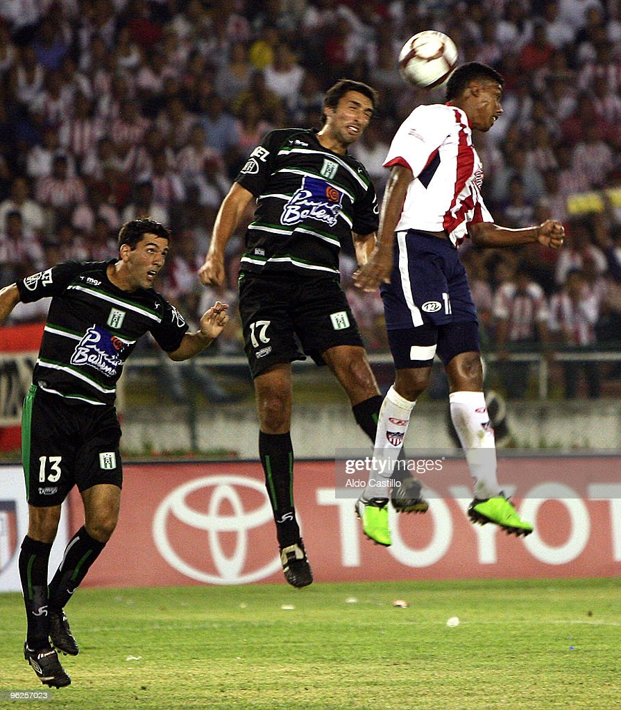Pablo Cesar Arango (R) of Colombia's Junior figths for the ball with Ignacio Pallas and Danny Tejera of Uruguay's Racing during their match as part of the Santander Libertadores Cup 2010 at Metropolitano Roberto Melendez Stadium on January 28, 2010 in Barranquilla, Colombia.