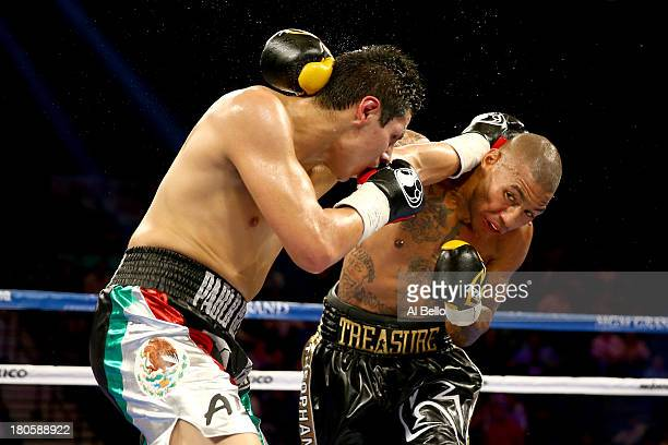 Pablo Cesar Cano and Ashley Theophane exchange blows during their welterweight fight at the MGM Grand Garden Arena on September 14, 2013 in Las...