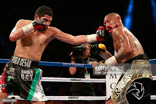 Pablo Cesar Cano lands a left to the face of Ashley Theophane during their welterweight fight at the MGM Grand Garden Arena on September 14, 2013 in...