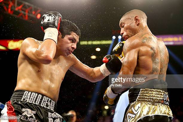 Pablo Cesar Cano throws a left to the body of Ashley Theophane during their welterweight fight at the MGM Grand Garden Arena on September 14, 2013 in...