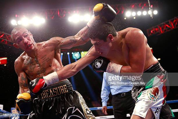 Pablo Cesar Cano throws a right to the body of Ashley Theophane during their welterweight fight at the MGM Grand Garden Arena on September 14, 2013...