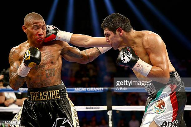 Pablo Cesar Cano throws a right to the head of Ashley Theophane during their welterweight fight at the MGM Grand Garden Arena on September 14, 2013...