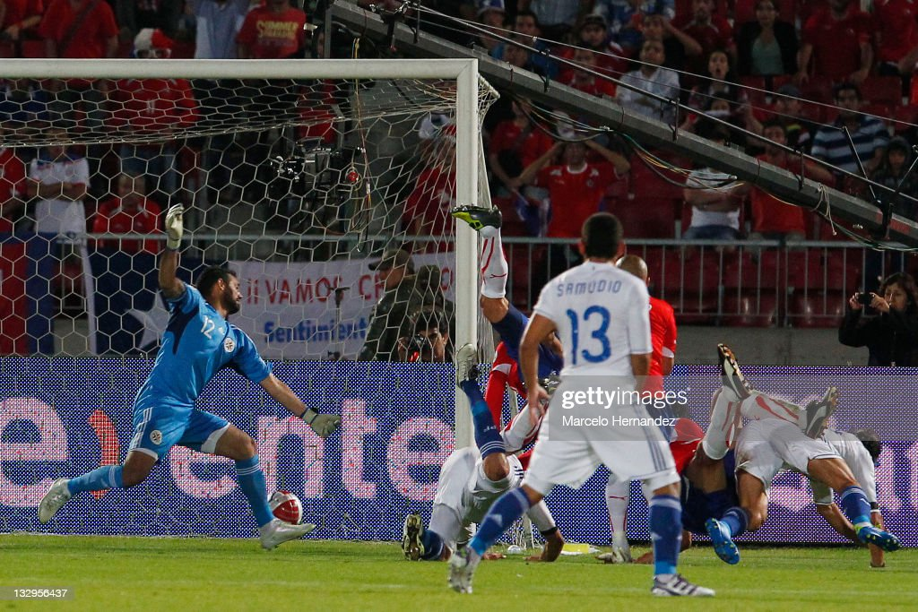 Pablo Contreras (R), from Chile, score his goal against Paraguay, during the match between Chile and Paraguay as part of the South American Qualifiers for Brazil 2014 FIFA World Cup on November 15, 2011 in Santiago, Chile.