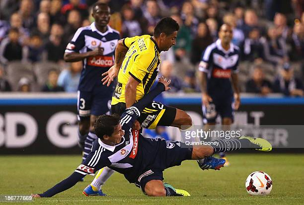 Pablo Contreras of the Victory and Carlos Hernandez of the Phoenix contest for the ball during the round four ALeague match between Melbourne Victory...