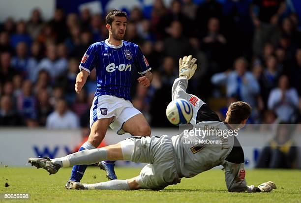 Pablo Counago of Ipswich beats an outstretched David Marshall of Norwich during the CocaCola Championship match between Ipswich Town and Norwich City...