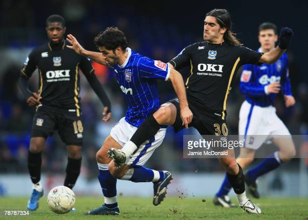 Pablo Counago of Ipswich is challenged by Pedro Mendes of Portsmouth during the FA Cup sponsored by EON 3rd Round match between Ipswich Town and...