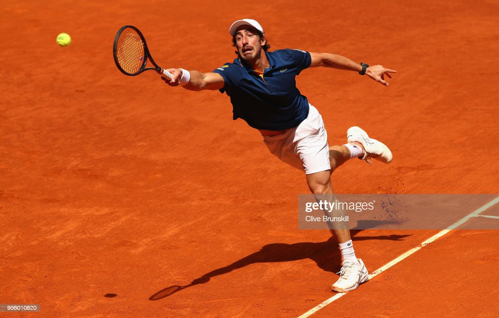 Pablo Cuevas of Argentina stretches to play a forehand against Jack Sock of the United States in their first round match during day four of the Mutua Madrid Open tennis tournament at the Caja Magica on May 8, 2018 in Madrid, Spain.