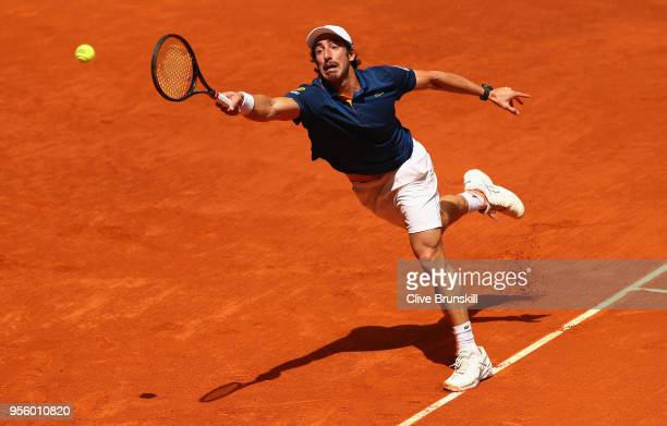Pablo Cuevas of Argentina stretches to play a forehand against Jack Sock of the United States in their first round match during day four of the Mutua...