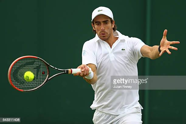Pablo Cuevas of Uraguay plays a forehand shot during the Men's Singles first round match against Andrey Kuznetsov of Russia on day one of the...