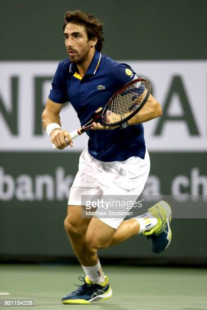 Pablo Cuevas of Uraguay plays Dominic Thiem of Austria during the BNP Paribas Open at the Indian Wells Tennis Garden on March 12 2018 in Indian Wells...