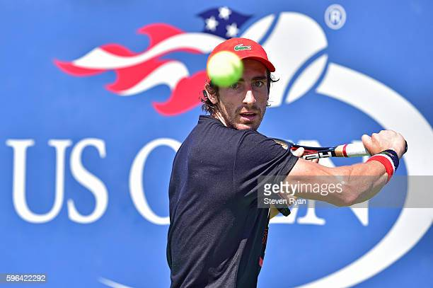 Pablo Cuevas of Uraguay practices during Arthur Ashe Kids' Day prior to the start of the 2016 US Open at USTA Billie Jean King National Tennis Center...