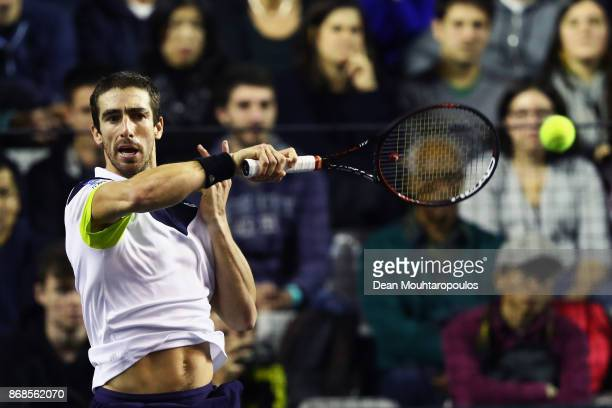 Pablo Cuevas of Uraguay returns a forehand against Karen Khachanov of Russia during Day 2 of the Rolex Paris Masters held at the AccorHotels Arena on...