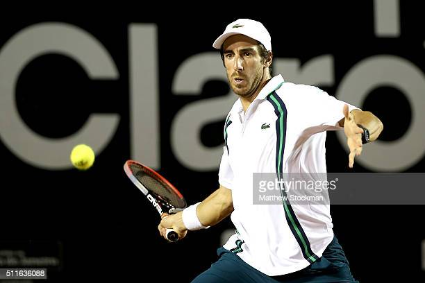 Pablo Cuevas of Uraguay returns a shot against Guido Pella of Argentina during the final of the Rio Open at Jockey Club Brasileiro on February 21...