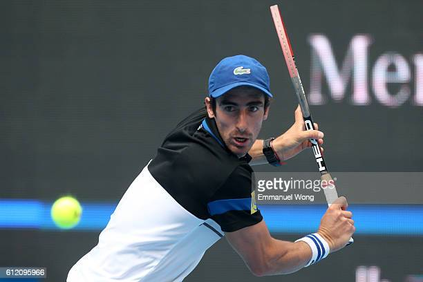 Pablo Cuevas of Uraguay returns a shot to David Ferrer of Spain during the Men's singles first round match on day three of the 2016 China Open at the...
