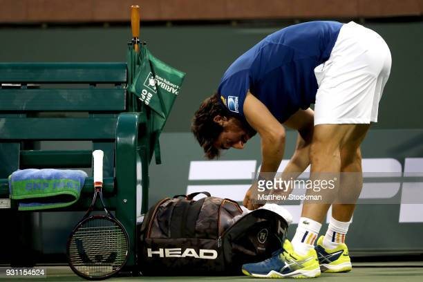 Pablo Cuevas of Uraguay unpacks his racquet before playing Dominic Thiem of Austria during the BNP Paribas Open at the Indian Wells Tennis Garden on...