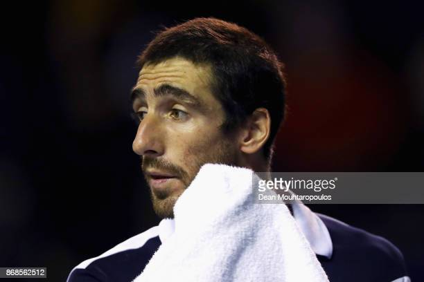 Pablo Cuevas of Uraguay wipes his face with a towel in his match against Karen Khachanov of Russia during Day 2 of the Rolex Paris Masters held at...