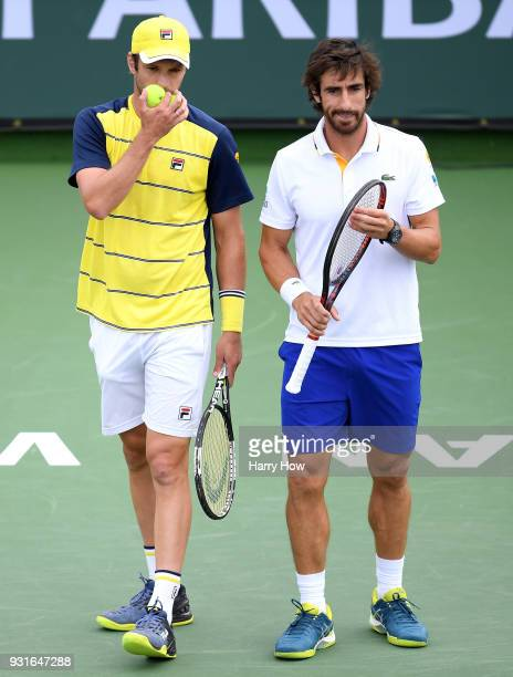 Pablo Cuevas of Uruguay and Horacio Zeballos of Argentina talk in their match against PierreHugues Herbert and Nicolas Mahut of France during the BNP...