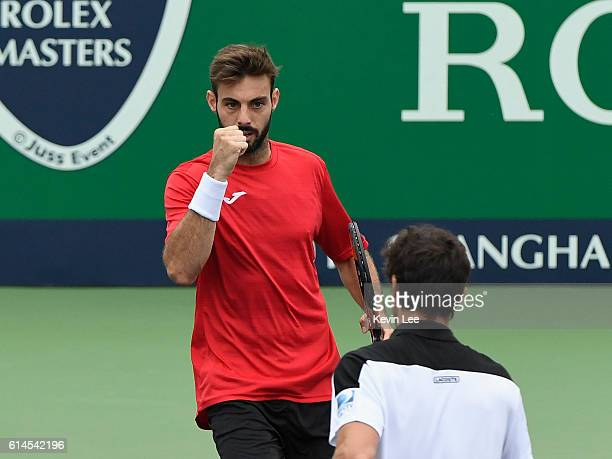 Pablo Cuevas of Uruguay and Marcel Granollers of Spain react during their Men's double QuarterFinal match against Marin Cilic of Croatia and Mate...