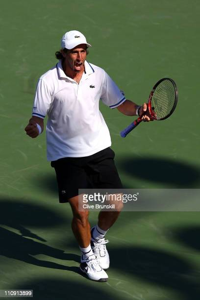 Pablo Cuevas of Uruguay celebrates after he won match point against Andy Roddick during the Sony Ericsson Open at Crandon Park Tennis Center on March...