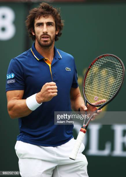 Pablo Cuevas of Uruguay celebrates winning his match against Denis Shapovalov of Canada during the BNP Paribas Open at the Indian Wells Tennis Garden...