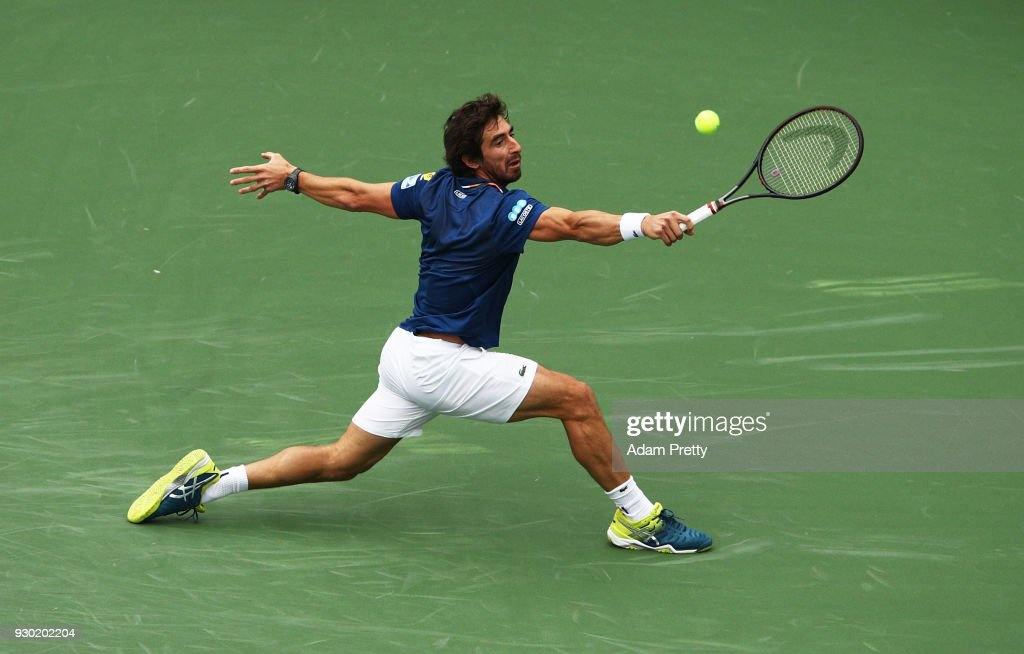 Pablo Cuevas of Uruguay hits a backhand during his match against Denis Shapovalov of Canada during the BNP Paribas Open at the Indian Wells Tennis Garden on March 10, 2018 in Indian Wells, California.