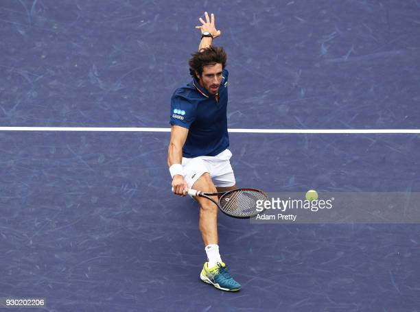 Pablo Cuevas of Uruguay hits a backhand during his match against Denis Shapovalov of Canada during the BNP Paribas Open at the Indian Wells Tennis...