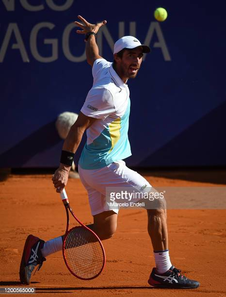 Pablo Cuevas of Uruguay hits a backhand during his Men's Singles match against Albert Ramos Vinolas of Spain during day 4 of ATP Buenos Aires...