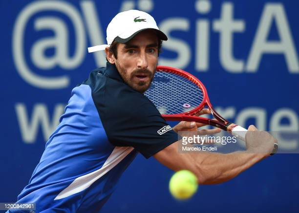 Pablo Cuevas of Uruguay hits a backhand during his Men's Singles match against Diego Schwartzman of Argentina during day 5 of ATP Buenos Aires...