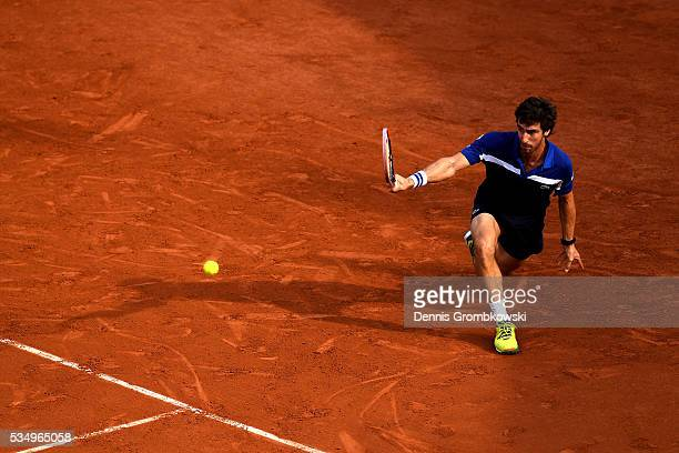 Pablo Cuevas of Uruguay hits a backhand during the Men's Singles third round match against **** on day seven of the 2016 French Open at Roland Garros...