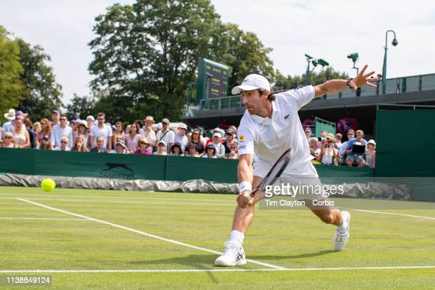 July 4: Pablo Cuevas of Uruguay in action in the Gentlemen's Doubles tournament with partner Marcel Granollers of Spain during the Wimbledon Lawn...