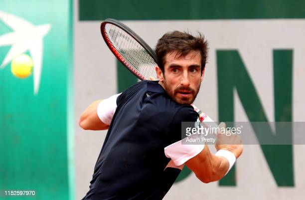 Pablo Cuevas of Uruguay plays a backhand during his mens singles second round match against Kyle Edmund of Great Britain during Day five of the 2019...