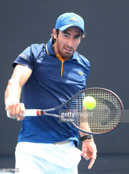 Pablo Cuevas of Uruguay plays a backhand in his first round match against Mikhail Youzhny of Russia on day one of the 2018 Australian Open at...