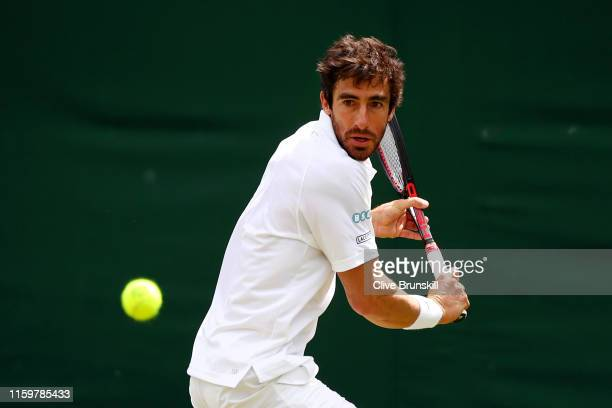 Pablo Cuevas of Uruguay plays a backhand in his Men's Singles second round match against Jiri Vesely of Czech Republic during Day three of The...