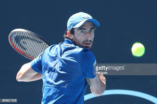 Pablo Cuevas of Uruguay plays a backhand in his second round match against Ryan Harrison of the United States on day three of the 2018 Australian...