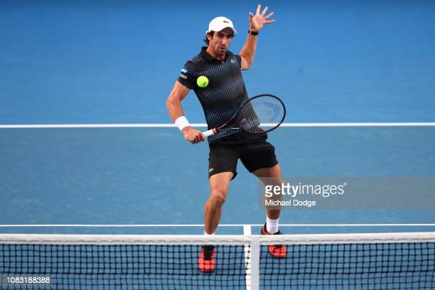 Pablo Cuevas of Uruguay plays a backhand volley in his second round match against Grigor Dimitrov of Bulgaria during day three of the 2019 Australian...