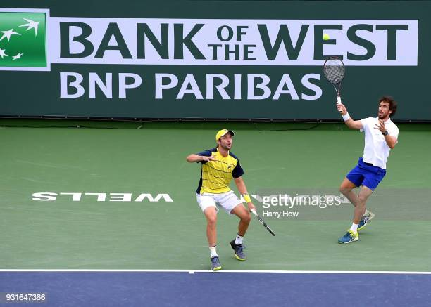 Pablo Cuevas of Uruguay plays a forehand in front of Horacio Zeballos of Argentina in their match against PierreHugues Herbert and Nicolas Mahut of...
