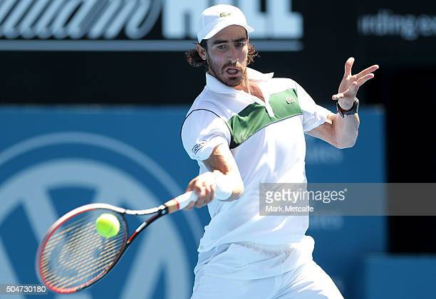 Pablo Cuevas of Uruguay plays a forehand in his match against Grigor Dimitrov of Bulgaria during day four of the Sydney International at Sydney...