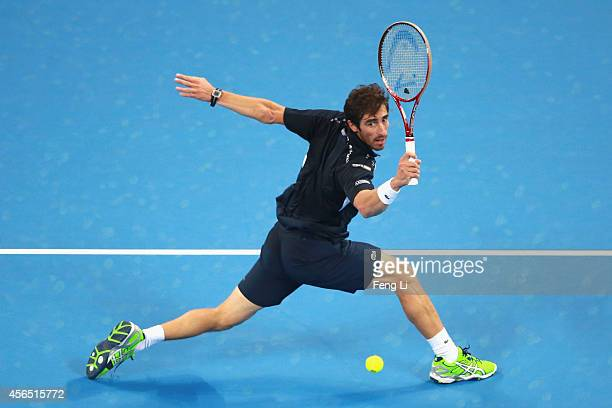 Pablo Cuevas of Uruguay returns a shot against Andy Murray of Great Britain during day six of of the China Open at the National Tennis Center on...