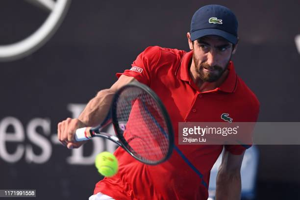 Pablo Cuevas of Uruguay returns a shot against Dominik Koepfer of Germany during men's qualifying singles 2nd round match of 2019 China Open at the...