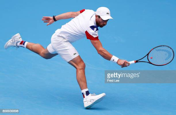 Pablo Cuevas of Uruguay returns a shot against Juan Martin del Potro of Argentina during the Men's singles first round on day four of 2017 China Open...