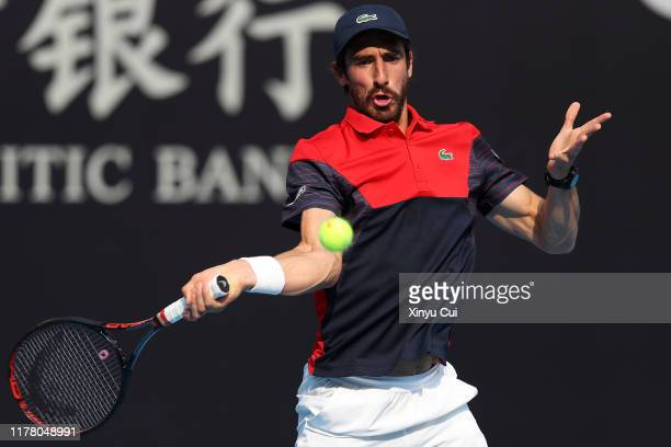 Pablo Cuevas of Uruguay returns a shot against Karen Khachanov of Russia during the Men's singles first round match of 2019 China Open at the China...