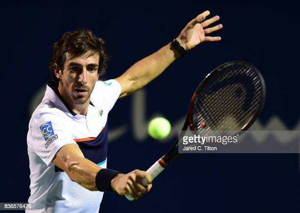 Pablo Cuevas of Uruguay returns a shot from JanLennard Struff of Germany during the third day of the WinstonSalem Open at Wake Forest University on...